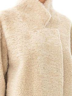 reversible curly shearling coat