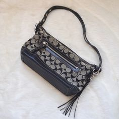 Coach Grey and Black Purse with Dustbag Coach grey and black Signature C Logo purse. Excellent condition except small defect in fabric. Comes with dustbag. Coach Bags
