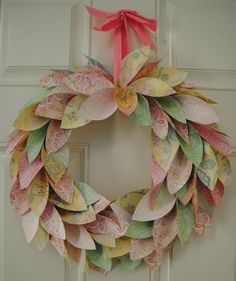Paper Wreath - made from wall paper. Would be almost free to make as you could simply collect wallpaper samples in toning colours to make the 'leaves'. The only costs would be the glue, the base (unless you already had something) and the ribbon to hang it by!