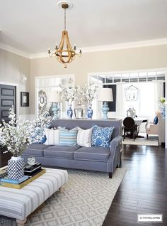 SPRING IN FULL SWING HOME TOUR 2017 Eldon Stripe pillow, Java Batik pillow and Henderson Stripe Pillow from Tonic Living. Bring freshness to your home this Spring with layers of beautiful blues, fresh and faux florals, and new modern art and textiles. Coastal Living Rooms, Living Room Colors, Living Room Grey, Home Living, Living Room Sofa, Living Room Interior, Living Room Designs, Apartment Living, Living Room Ideas Tan Walls