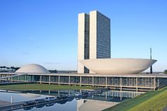 Located in the middle of Brasília's Monumental Axis, the city's main thoroughfare, the National Congress building is made up of a low structure topped by a dome on one side, where the Senate works, and an inverted dome on the other, where the Chamber of Deputies resides. The second structure is a pair of towers, visually in the middle of the two domes, that house governmental office space. The complex was completed in 1960.