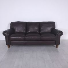 Cocoa Leather Sofa. - Plush three-seat brown leather couch- Good condition with no damage to note- Seat height: 18""