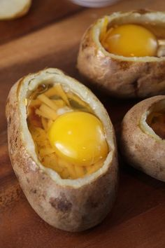 Twice baked breakfast potato: butter insides, add cheese, bacon pieces, top with the egg, salt pepper. Pop into the oven @ 350 for about 15 - 20 minutes. Keep an eye on them, dont over cook the egg. Top with cheese, bacon, green onions and some sour cream. Yummy