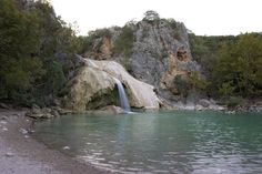 Turner Falls Park, OK 2 hours north of Dallas. Miles of trails, creeks, camping, waterfalls, and rock castle