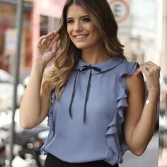 Ruffled blue blouse