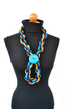 This color block scarf necklace is suitable in various way.  Its composed by four colors wool thread and decorated with a big teal pin button.    For a pop
