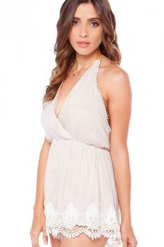 Sink your teeth in to something sweet and treat yourself to a timeless style. The Honeydew Lace Trim Romper has all the bells and whistles; with a surplice top and stretchy elastic waist in a warm woven taupe and fluttering shorts below. Lace trim lines the top of the bodice and larger insets decorate the bottom hem. A low cut back ties at the top behind the neck for a customizable fit! Wear it for all your bridal or brunch necessities with a sweet pair of wedges and chic arm candy!