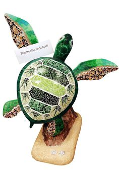 """""""Green Mosaic"""" turtle sculpture decorated by art students from The Benjamin School."""