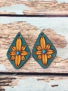 Hand tooled leather earrings Dyed Turquoise and yellow Light weight Small faux turquoise spot rivet 2 long 1 1/2 wide Stainless steel hardware Genuine leather