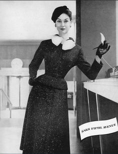 1954 Nancy Berg in snowflake tweed suit with white satin bow from Saks Fifth Avenue, hat by Tatiana (du Plessix Liberman) of Saks Fifth Avenue, Harper's Bazaar,