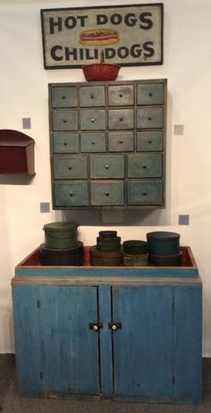 """19th century New England paint decorated 18 drawer Apothecary, with the original dry blue paint,decorated with a thin blue pin strip on each drawer, dovetailed drawers , Circa 1820measurements are: 10"""" deep x 28 1/2"""" wide x 30 3/4"""" tall"""