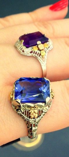 Two antique gemstone and filigree rings, one sapphire and one amethyst. Via Diamonds in the Library