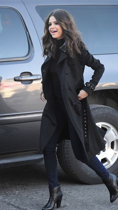 Chic in booties and a matching belted trench coat, singer Selena Gomez takes a walk during the Sundance Film Festival.