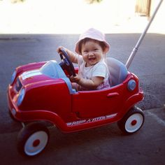 Look who's got a sweet new ride! Ruby's been watching our neighbor's kids ride their bikes and nas been itching to be mobile like that. So Bob's been researching push cars to see which one was just right for her....