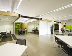 This looks like a truly flexible space: sliding whiteboard panels that close up into mini-lecture spaces and then open up into larger work and collaboration spaces.