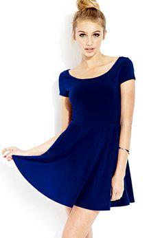 Darling Skater Dress. A skater dress featuring a shallow neckline. Short sleeves. Stretch knit. Lightweight.
