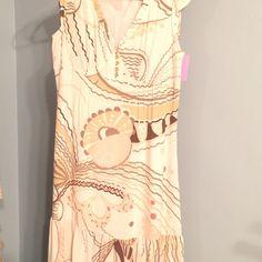 Beige in Carmel and off-white dress Shortsleeve beige and caramel geometrical print dress Dresses Midi