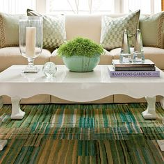 How To Decorate Your Coffee Table:    1. Something Tall   Hurricane vases or candlesticks are great; when you light candles, they add sparkle and make everything festive.    2. One Oddball Object   Choose something that's sculptural and quirky to express your personality.     3. Something Fresh   A nice pot of ivy, a fern, or some fresh flowers add life and easy to change color.    4. A Stack of Books   Use a few large, pretty art books to make a stack; top it off with something decorative.