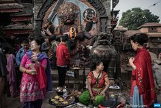 NEPAL, Kathmandu : Devotees gather at the high stone image of Kala  Bhairava at Durbar Square, in the historical centre of Kathmandu on May  10, 2015. The 7.8 magnitude earthquake which struck the Himalayan nation  on April 25, 2015 has had a devastating impact on the economy of Nepal  where tourism attracted almost 800,000 foreign visitors in 2013 – many  of them climbers heading straight to Mount Everest but also less  adventurous tourists seeking the rich cultural history of Kathman...