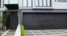 Concrete slate matching front and garage doors. Love the personality of the finish. Metal Garage Doors, Modern Garage Doors, Door Gate Design, Garage Door Design, Garages, Concrete Coatings, Axolotl, Building Facade, Entry Doors