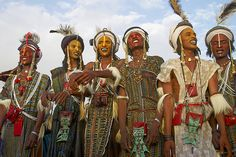 Wodaabe (Bororo) men with faces painted at the annual Gerewol male beauty…
