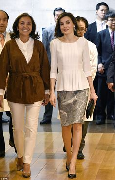 Spain's Queen Letizia walked alongside Carmen Vela, the country's Secretary of State for Investigation, Development and Innovation, at a hospital in Japan