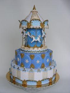 Carousel cake in blue for a boy's baby shower, in pink for a girls baby shower. Brilliant and stunning!