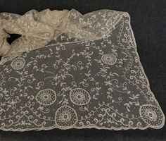 Tambour embroidery on net  shawl