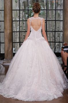Marseille For our brides dreaming of a fairytale winter wedding, we love this gown with classic sweetheart neckline and voluminous layers of glittering tulle.