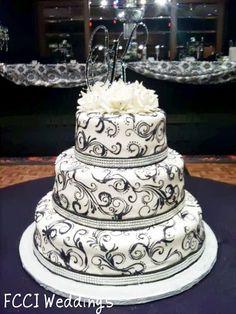 Beautifully detailed black and white wedding cake.