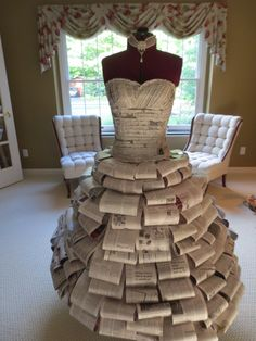 Paper dress created for a bridal shower. By Taylor Heberling