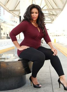 Look for plus size tops that have deep v necklines. You could choose them in darker colour while choosing to wear a lighter coloured camisole underneath. This would slice up the torso in two parts adding more femininity t o your body.