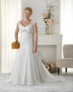 1516 Unforgettable by Bonny Bridal - Deconstructed lace plus size wedding gown with cap sleeves.