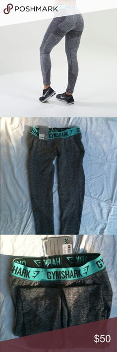 Gymshark Flex Leggings in Charcoal Marl/Turquoise Brand New (never worn, with tags) Gymshark Flex Leggings in Charcoal Marl/Pale Turquoise (size M). Currently sold out, shipping from the US. Bought directly from the Gymshark website (I can send you a screenshot of the purchase confirmation email). gymshark Pants Leggings
