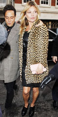 Supermodel Moss celebrated her 40th birthday in a LBD topped with a fierce leopard-print coat. A pale-pink Chanel clutch and black lace-up booties served as her accessories.