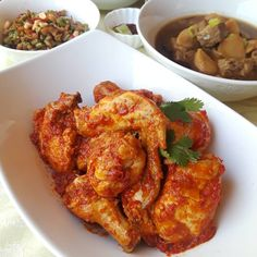 Chicken cooked in chili.  #chiliayam #chiligaram #chiligaramchicken #baba #babanyonya #peranakan #peranakanfood #malaysianfood #nyonyafood #nyonya #nyonyacuisine #nyonyacooking #nyonyarecipe #malaysia #malaysianfood #straitschinese #malacca #melaka #singapore #heritage #heritagefood #history #peranakanculture #chinesenewyear #lunarnewyear #babanyonyaperanakans Peranakan Food, Nyonya Food, Malaysian Food, Tandoori Chicken, Chicken Wings, Singapore, Chili, History, Cooking