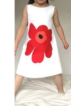 Organic Lucia Dress with a Red Marimekko Unikko Poppy applique, Age 5-6. £40.00, via Etsy.