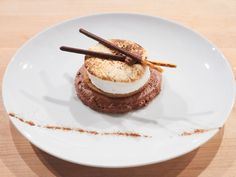 S'mores Through the Roof : Fresh homemade marshmallow is the star of this classed-up campfire dessert. Sitting atop a graham cracker and a sphere of chocolate mousse, the marshmallow is torched and topped with Japanese snack cookies that emulate the campfire sticks used to make a classic s'more.
