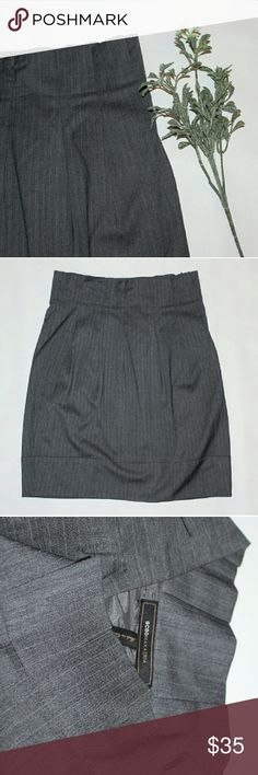 "🆕BCBGMAXAZRIA classy pencil skirt This is a high waisted style, feature ruffle hem at the top. Grey with pinstripe detail and two side pockets. Zipper at the side for closer.  22"" length Excellent condition BCBGMaxAzria Skirts Pencil"