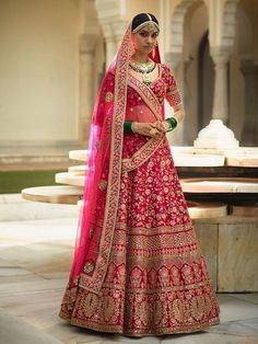 Pretty pink wedding lehenga choli online for women which is crafted from banarasi silk fabric with exclusive zari embroidey and stone work. Shop this stunning lehenga choli which comes with banarasi silk blouse and net dupatta.