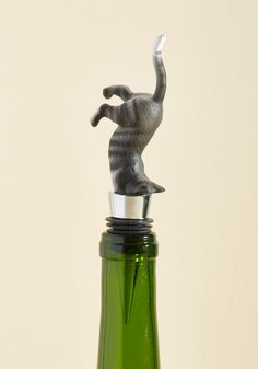 Quench Your Curiosity Wine Stopper. From merlots to moscatos, this quirky kitty wine stopper can't wait to taste 'em all! A testament to the smile-inspiring nature of our beloved feline companions, this bottle topper - with its white feet, striped body, and pointed ears affixed to a metal cone - may inspire a little mischief in you, too.