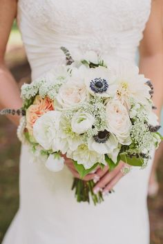 Rustic Wedding Bouquet featuring peaches, whites, greens, and a hint of lavender - Bridal Musings Wedding Blog  Photo credit: Lauren Fair Photography