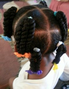 2 strand twist ponies. first time wearing barrettes & she loves them lol