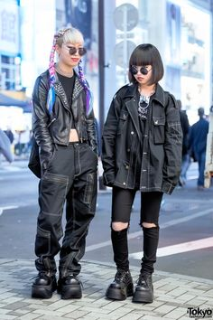19-year-old Rio (left) and 17-year-old Baek on the street in Harajuku wearing dark styles featuring items from Michiko London, Never Mind the XU, Angst Child, and Demonia.
