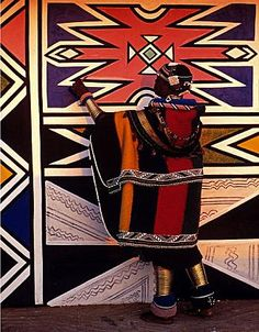 Ndebele patterns. Africa | Ndebele houses are painted by women who have been taught the techniques as part of their girlhood initiations. Originally, the designs, painted in mud and naturally occurring oxides, were comparatively muted. Today, the women use commercial paints, that although more costly, are intensely colored & do not deteriorate from the effects of weather. From the postcard book AFRICAN CEREMONIES | © Angela Fisher and Carol Beckwith