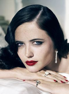 black hair blue eyes red lips. I don't know who she is, but I love the strong look in her eyes