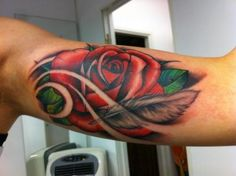 Rose / feather tattoo