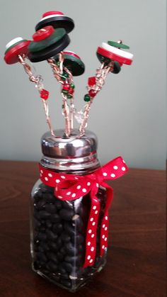 This cheerful, button bouquet in Christmas red, green, and white will brighten any spot in your home or office. A vintage inspired salt shaker filled with dried beans holds the unique flowers. The beautiful flowers are created with a mix of modern and vintage buttons. Beaded wire Red Christmas, Christmas Ideas, Christmas Gifts, Holiday, Button Art Projects, Button Crafts, Button Bouquet, Button Flowers, Unique Flowers
