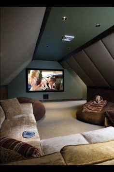Home theater room. Great use of attic space!