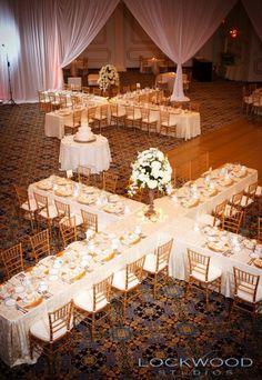 Glamorous white and gold wedding reception seating idea; Featured Photographer: Lockwood Studios